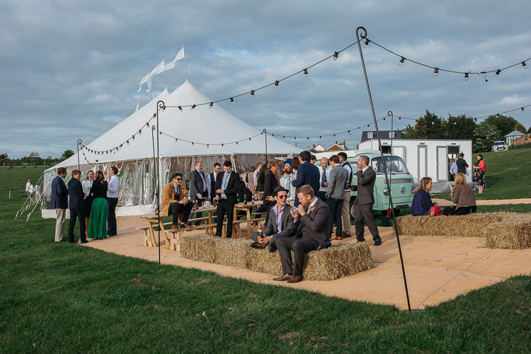 Papakata Sperry Tent Festoon Lighting Hay Bales Outdoor Farm Wedding 1970s Dress https://www.magdak.co.uk/