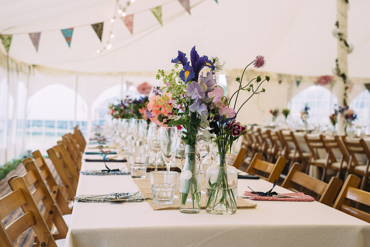 Mismatched Bottles Wild Flowers Burlap Hessian Runner Bunting Fun Laid Back DIY Rustic Marquee Wedding http://www.louisegriffinphotography.com/