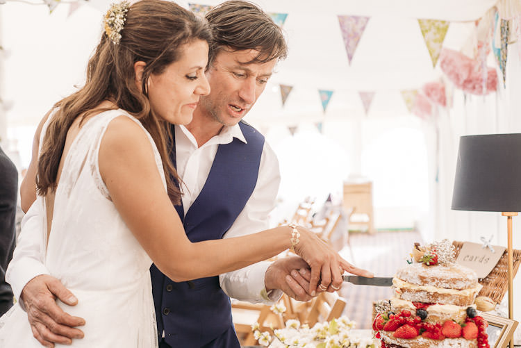 Cutting Naked Cake Charlie Brear Bride Reiss Groom Waistcoat Fun Laid Back DIY Rustic Marquee Wedding http://www.louisegriffinphotography.com/