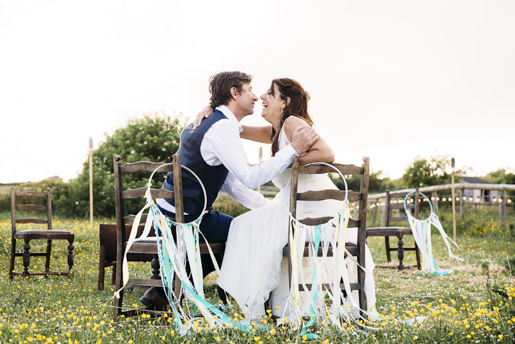 Dream Catchers Ribbon Chair Decoration Back Fun Laid Back DIY Rustic Marquee Wedding http://www.louisegriffinphotography.com/