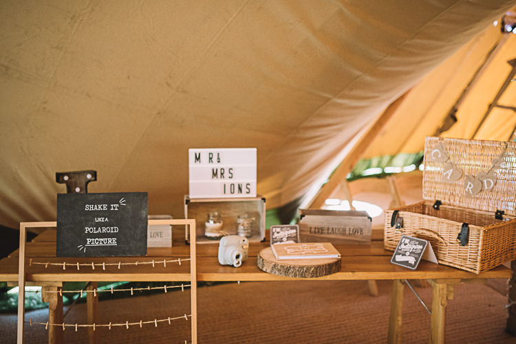 Polariod Guest Book Table Rustic Boho Summer Tipi Wedding https://www.luciewatsonphotography.com/