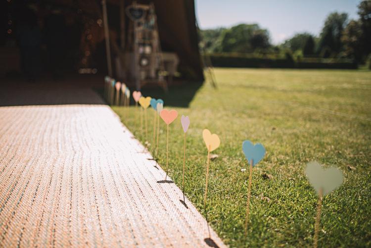 Hearts Sticks Walkway Path Rustic Boho Summer Tipi Wedding https://www.luciewatsonphotography.com/