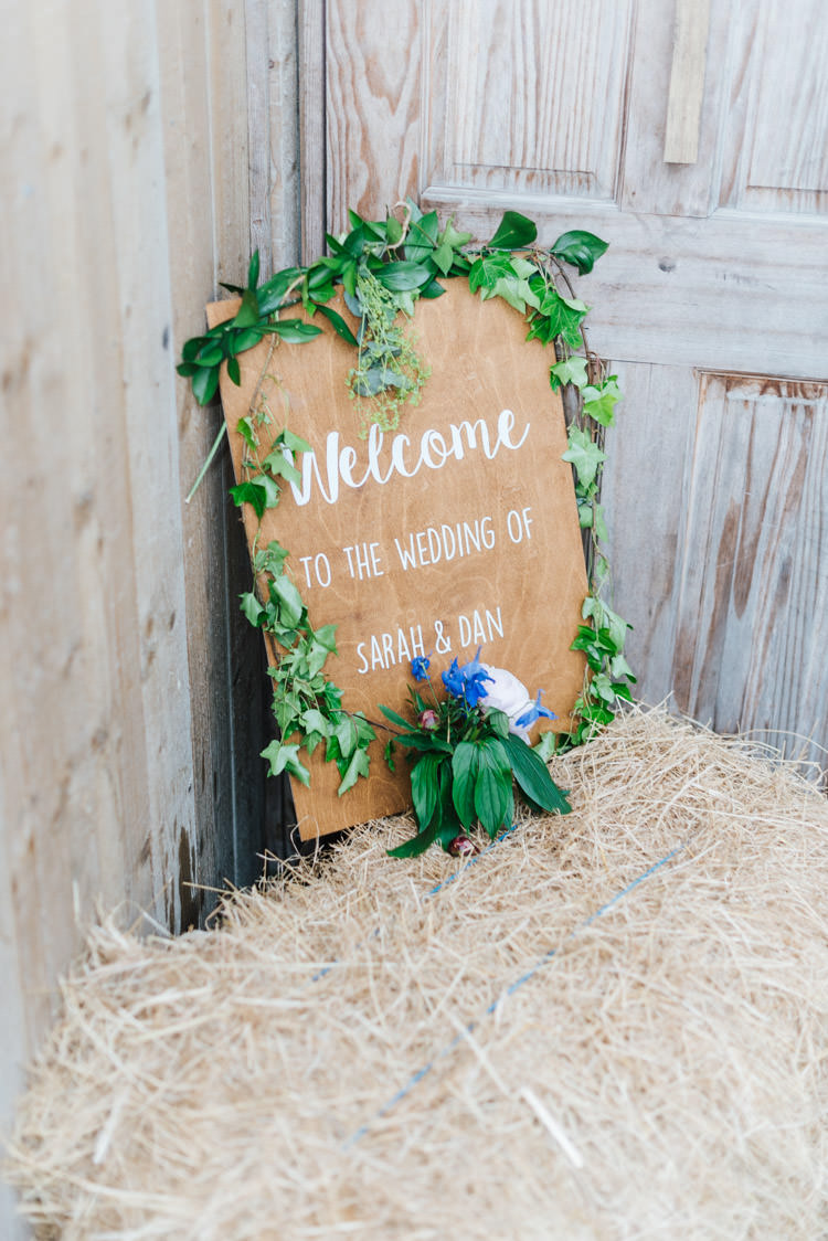 Wooden Painted Sign Calligraphy Greenery Foliage Whimsical Wedding Sea Rustic Barn http://sugarbirdphoto.co.uk/
