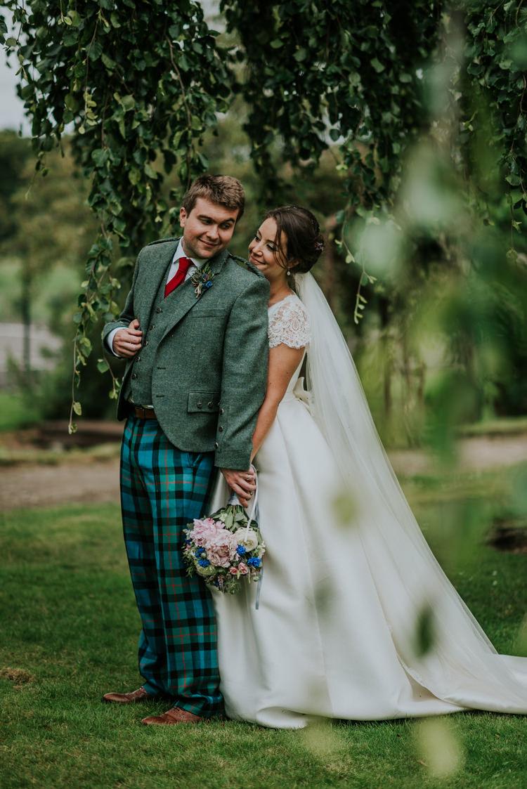 Tartan Trousers Groom Tweed Jacket Enchanting Cornflower Blue Marquee Wedding https://burfly.co.uk/