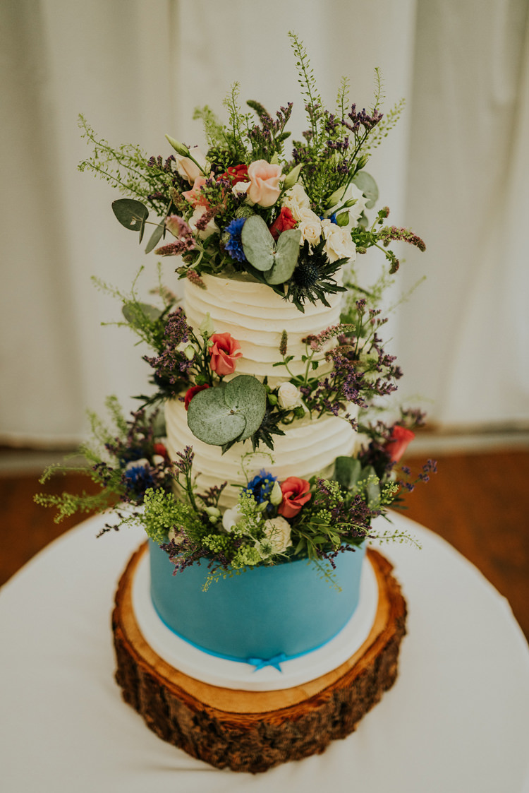 Buttercream Cake Rustic Log Stand Flowers Enchanting Cornflower Blue Marquee Wedding https://burfly.co.uk/