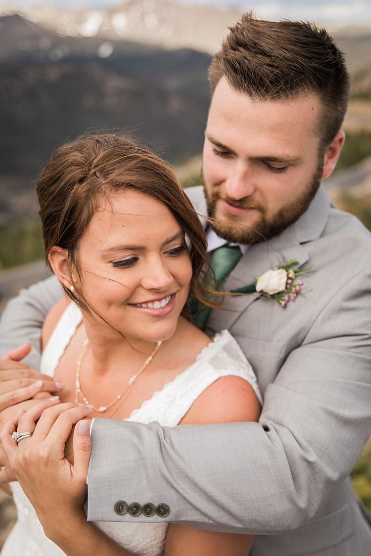 Bride Groom Embrace Scenic Rocky Mountain National Park Elopement http://allisonslaterphotography.com/