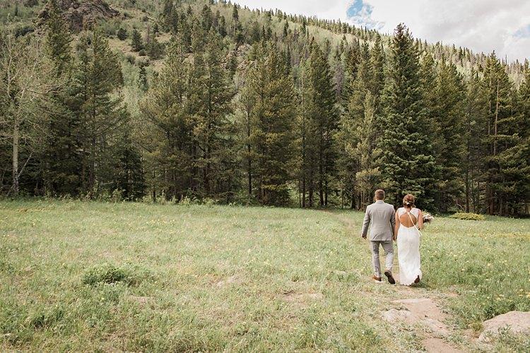 Bride Groom Walking Trees Scenic Rocky Mountain National Park Elopement http://allisonslaterphotography.com/