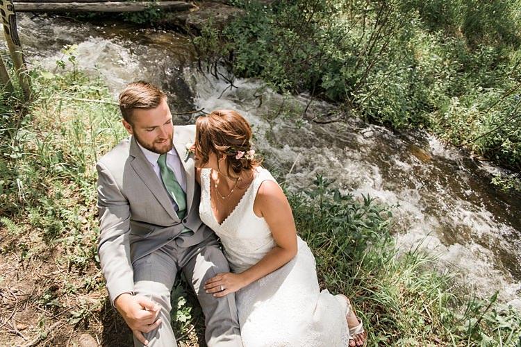 Bride Groom Sitting Stream Scenic Rocky Mountain National Park Elopement http://allisonslaterphotography.com/