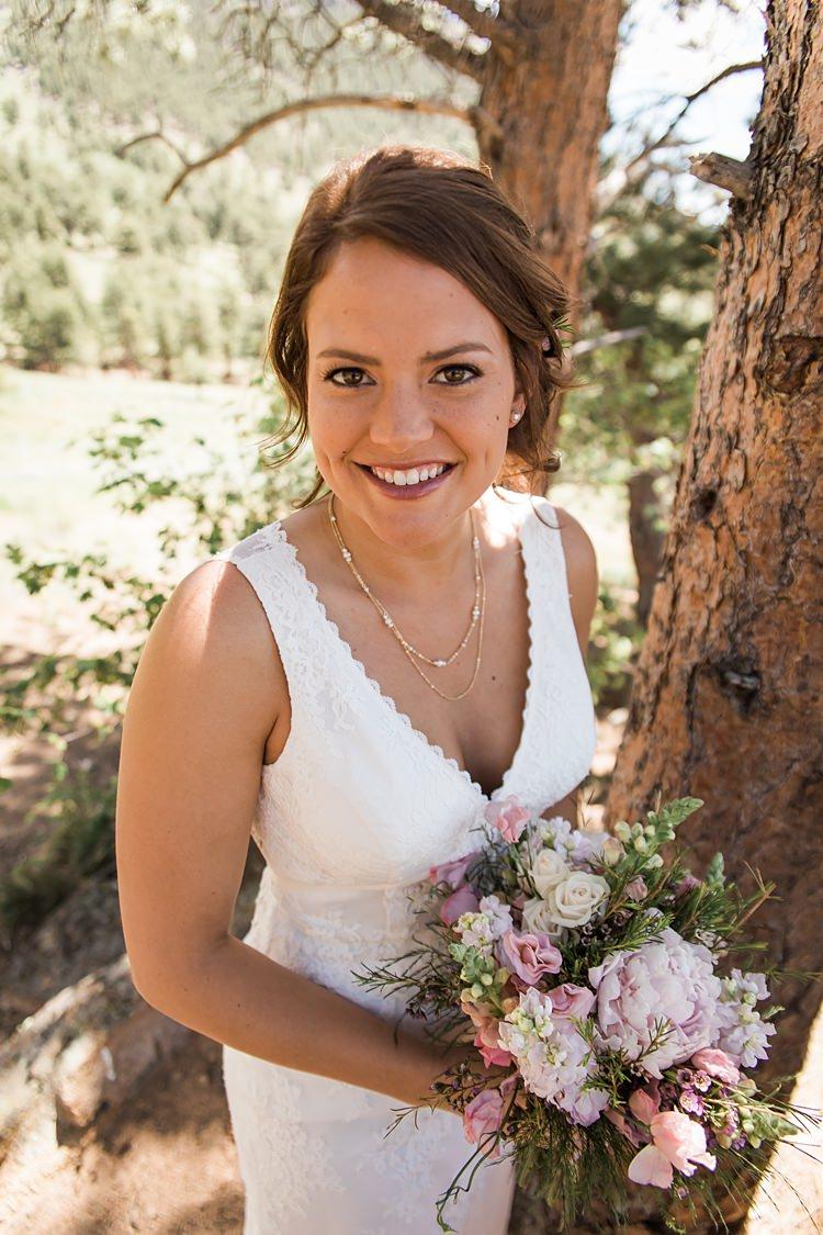Bride Smiling Bouquet Scenic Rocky Mountain National Park Elopement http://allisonslaterphotography.com/