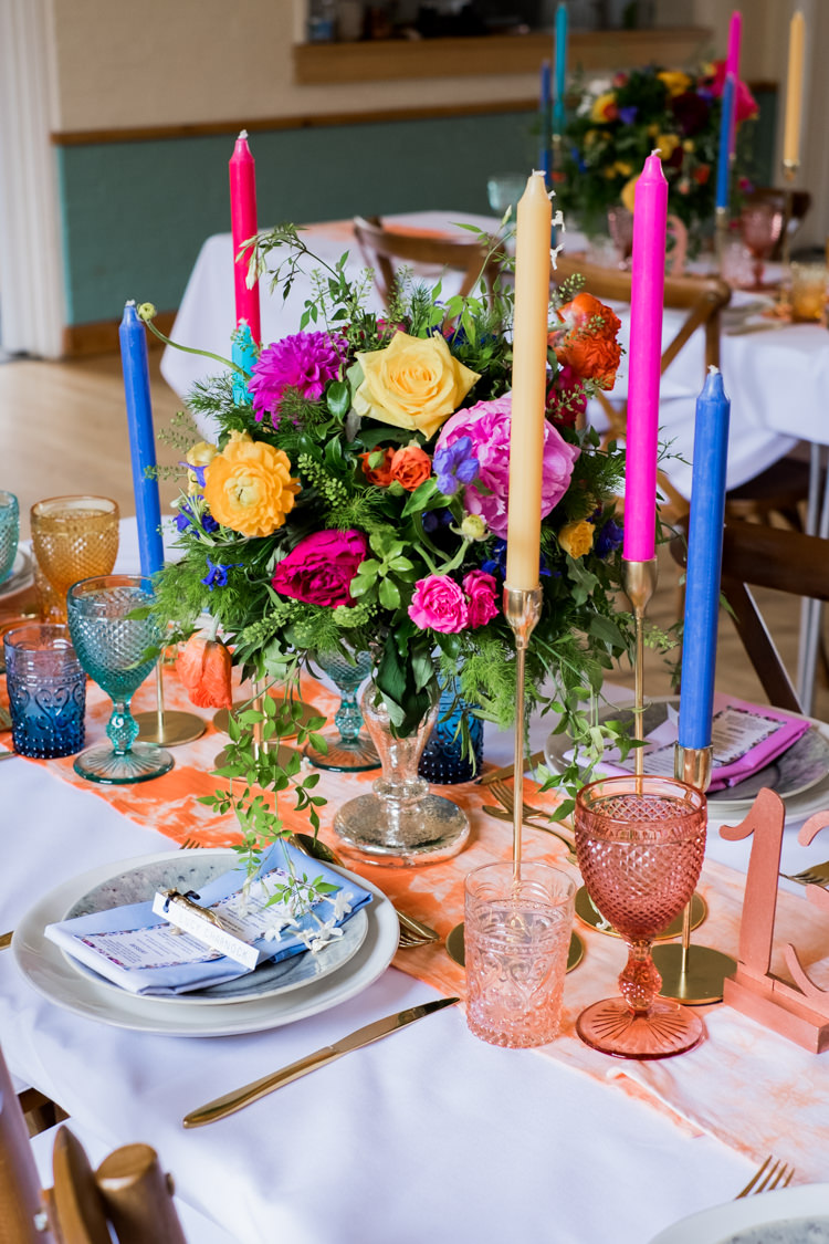 Decor Tablescape Table Centrepiece Tie Die Colourful Flowers Candles Whimsical Unicorn Rainbow Wedding http://clairemacintyre.com/