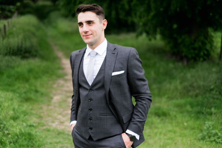 Grey Suit Groom Next Whimsical Unicorn Rainbow Wedding http://clairemacintyre.com/