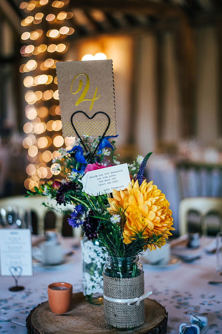 Centrepiece Jar Log Hessian Ribbon Colourful Hand Made Rustic Barn Flower Filled Wedding http://www.threeflowersphotography.co.uk/