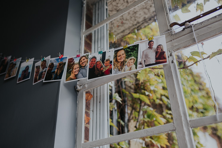 Polaroids Photographs String Pegs Low Key Colour Pop Local City Wedding http://www.kategrayphotography.com/
