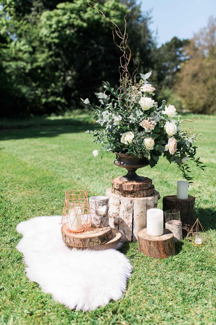 Foliage Flowers Roses Sheepskin Logs Decor Urn Bohemian Garden Greenery Wedding Ideas http://www.storytellerphotography.co.uk/