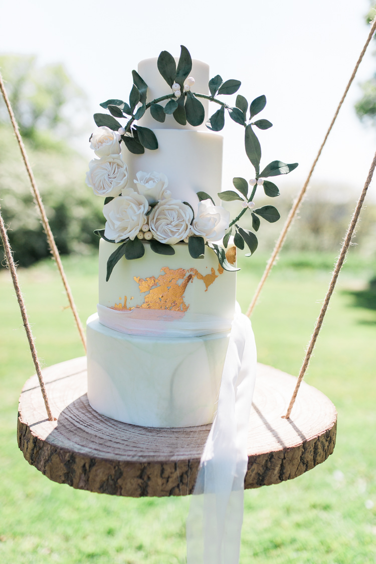 Marble Cake Wreath Gold Log Suspended Log Hanging Swing Bohemian Garden Greenery Wedding Ideas http://www.storytellerphotography.co.uk/