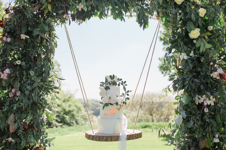 Marble Cake Wreath Gold Log Suspended Log Hanging Swing Flower Arch Bohemian Garden Greenery Wedding Ideas http://www.storytellerphotography.co.uk/