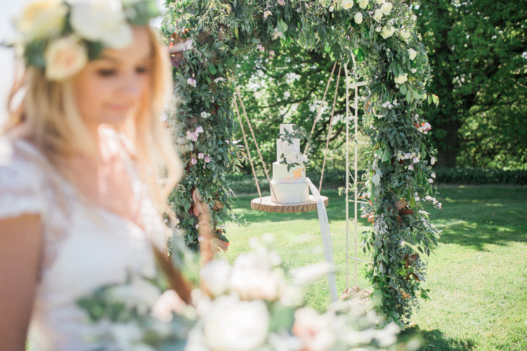 Marble Cake Wreath Gold Log Suspended Log Hanging Swing Arch Bohemian Garden Greenery Wedding Ideas http://www.storytellerphotography.co.uk/