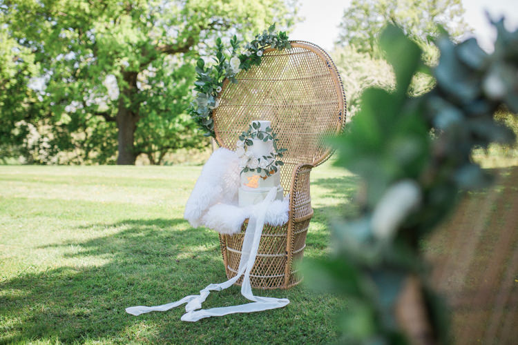Wicker Chair Flowers Cake Stand Bohemian Garden Greenery Wedding Ideas http://www.storytellerphotography.co.uk/