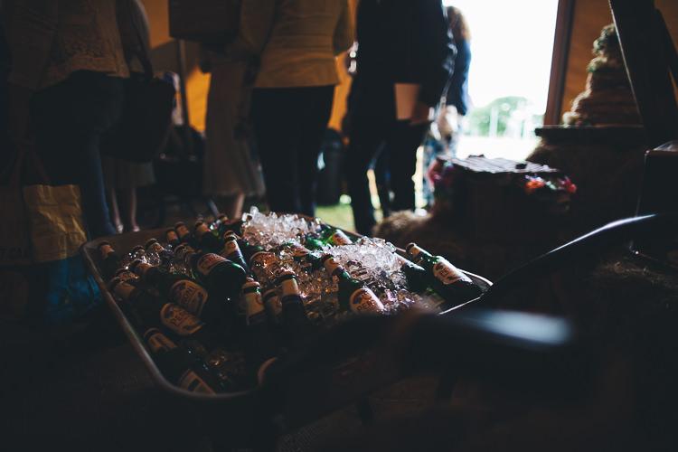 Wheelbarrow Booze Drinks Large DIY Bohemian Tipi Party Wedding http://www.mikeplunkettphotography.com/