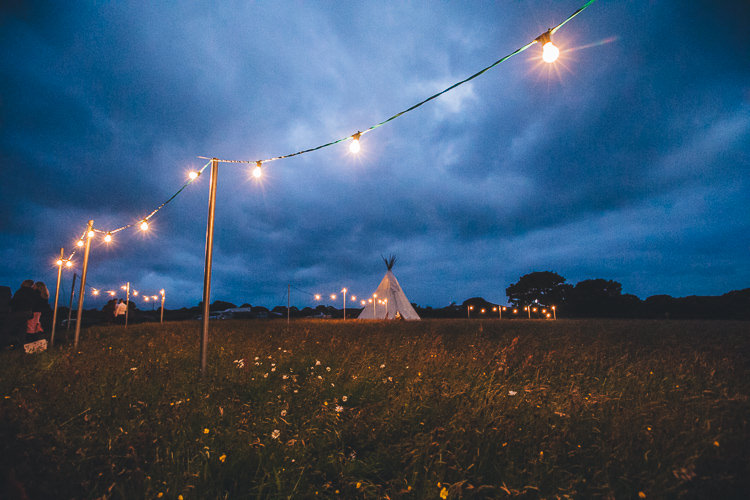 Festoon Lights Outdoors Large DIY Bohemian Tipi Party Wedding http://www.mikeplunkettphotography.com/