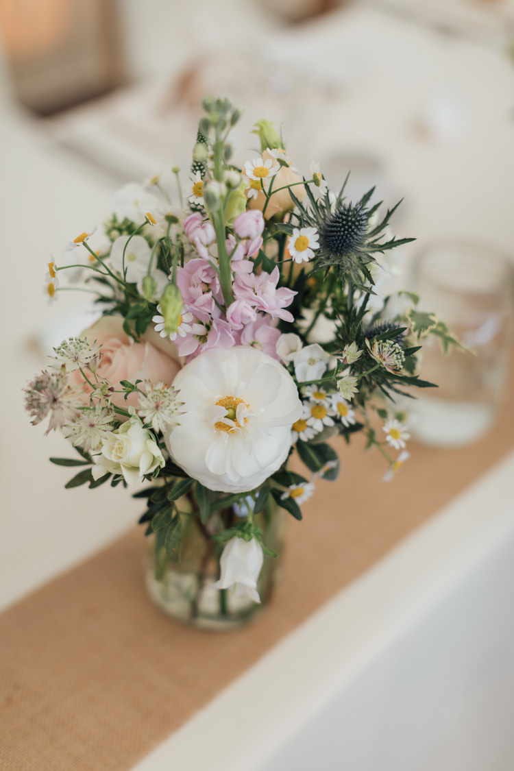 Jar Flowers Centrepiece Daisy Stocks Thisles Pretty Pale Pink Scenic Coast Wedding http://rachellambertphotography.co.uk/