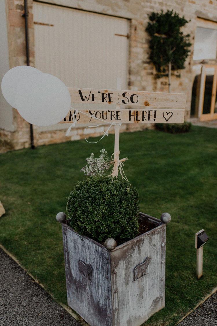 Painted Wooden Sign Balloons Dreamy Natural Boho Barn Wedding https://heychrisrandle.com/