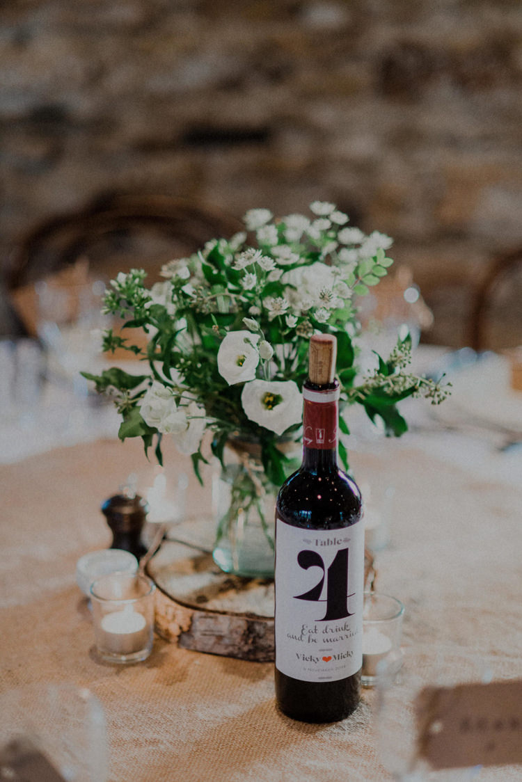 Centrepiece Flowers Log Hessian Wine Bottle Number Table Dreamy Natural Boho Barn Wedding https://heychrisrandle.com/
