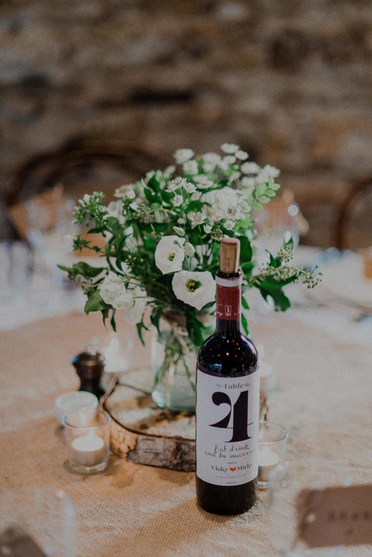 Centrepiece Flowers Log Hessian Wine Bottle Number Table Dreamy Natural Boho Barn Wedding https://heychrisrandle.com/