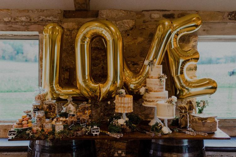 Cake Dessert Table LOVE Balloons Naked Drip Cakes Dreamy Natural Boho Barn Wedding https://heychrisrandle.com/