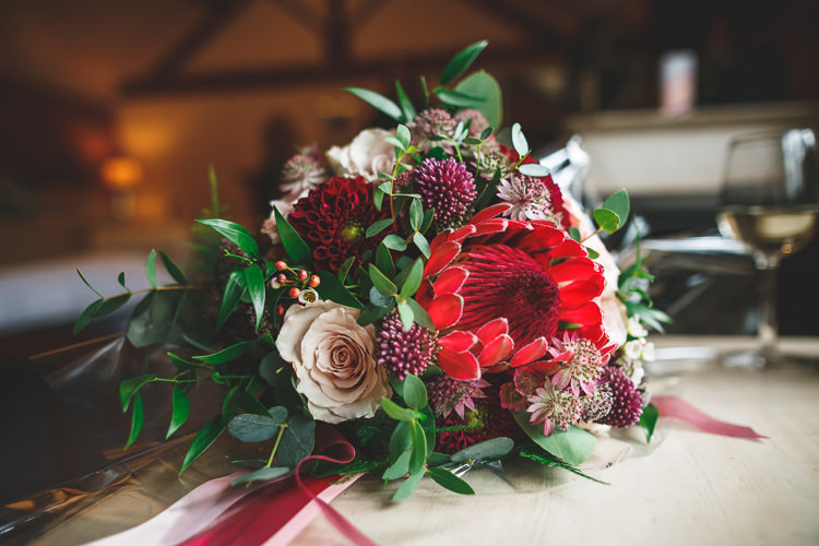 Bride Bridal Bouquet Rose Dhalia Greeenery Rustic Barn Red Gold Glam Wedding https://garethnewsteadphotography.com/