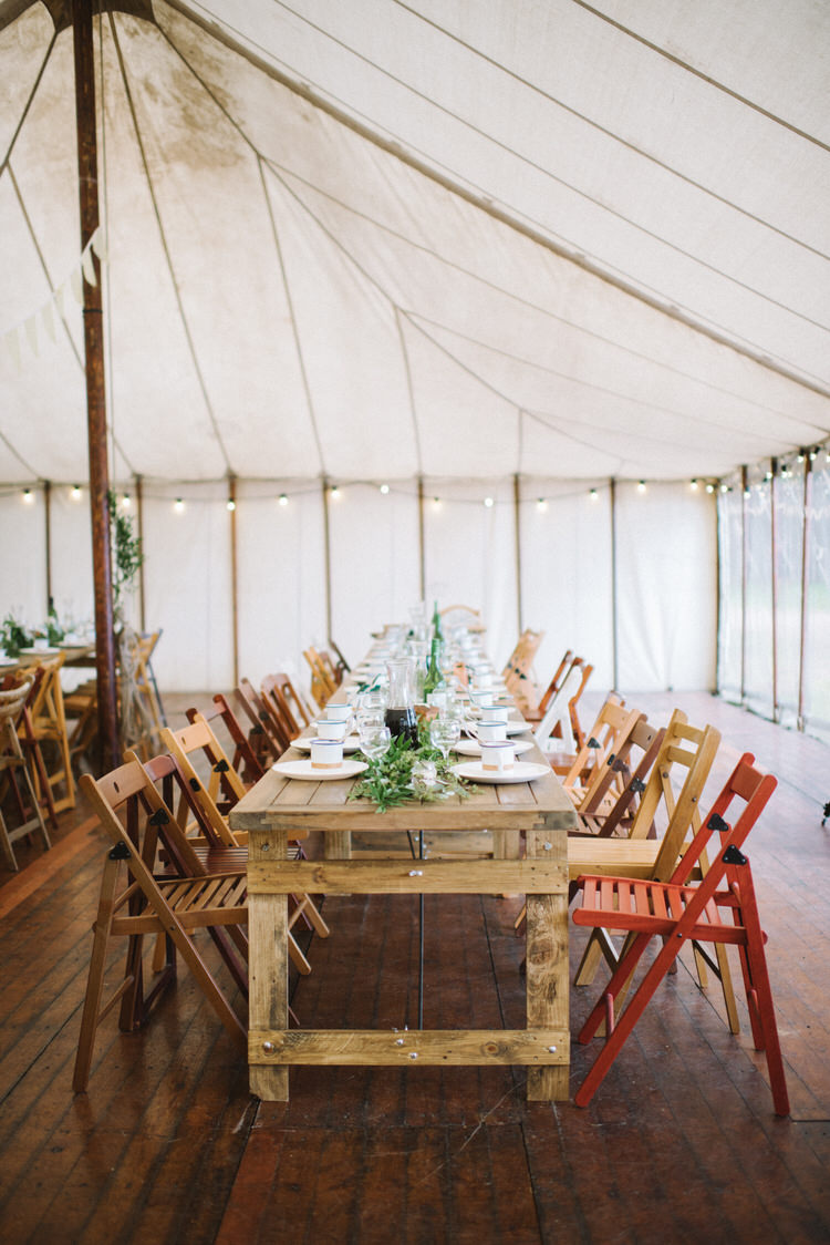Pole Marquee Festoon Lights Wooden Furniture Chairs Tables Vintage Log Cabin Wedding Sea http://www.lisadevinephotography.co.uk/