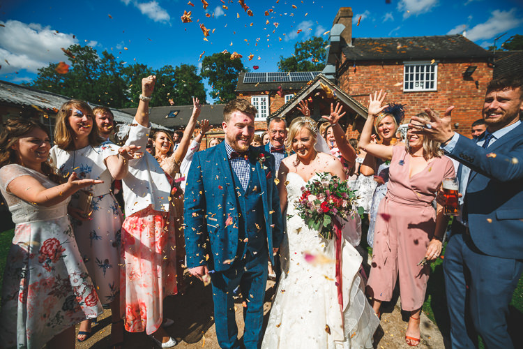 Confetti Shot Bride Bridal Sottero & Midgley Dress Gown Sweetheart Neckline Marc Darcy Groom Three Piece Waistcoat Bouquet Ribbon Rustic Barn Red Gold Glam Wedding https://garethnewsteadphotography.com/