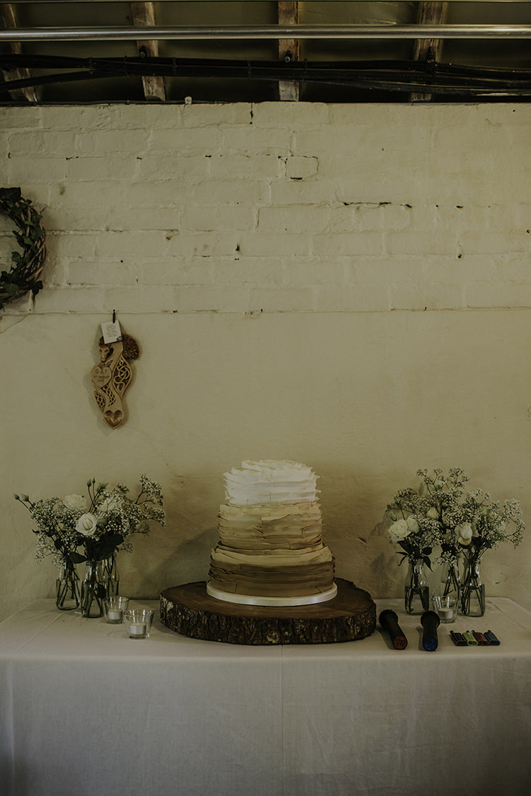 Ruffled Cake Brown White Log Enchanting Country Barn Wedding http://www.dmcclane.com/