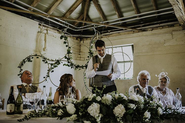 Hoop Greenery Backdrop Top Table Decor Enchanting Country Barn Wedding http://www.dmcclane.com/