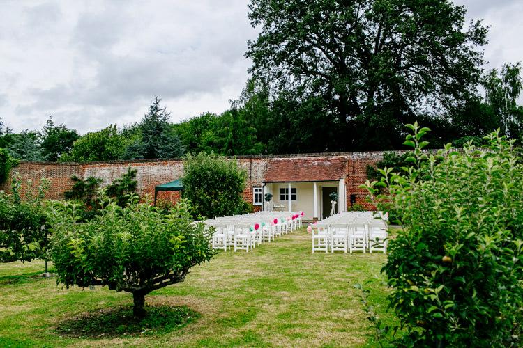 Walled Garden Outdoor Ceremony Chiavari Chairs Stylish Sassy Gin Wedding http://epiclovestory.co.uk/