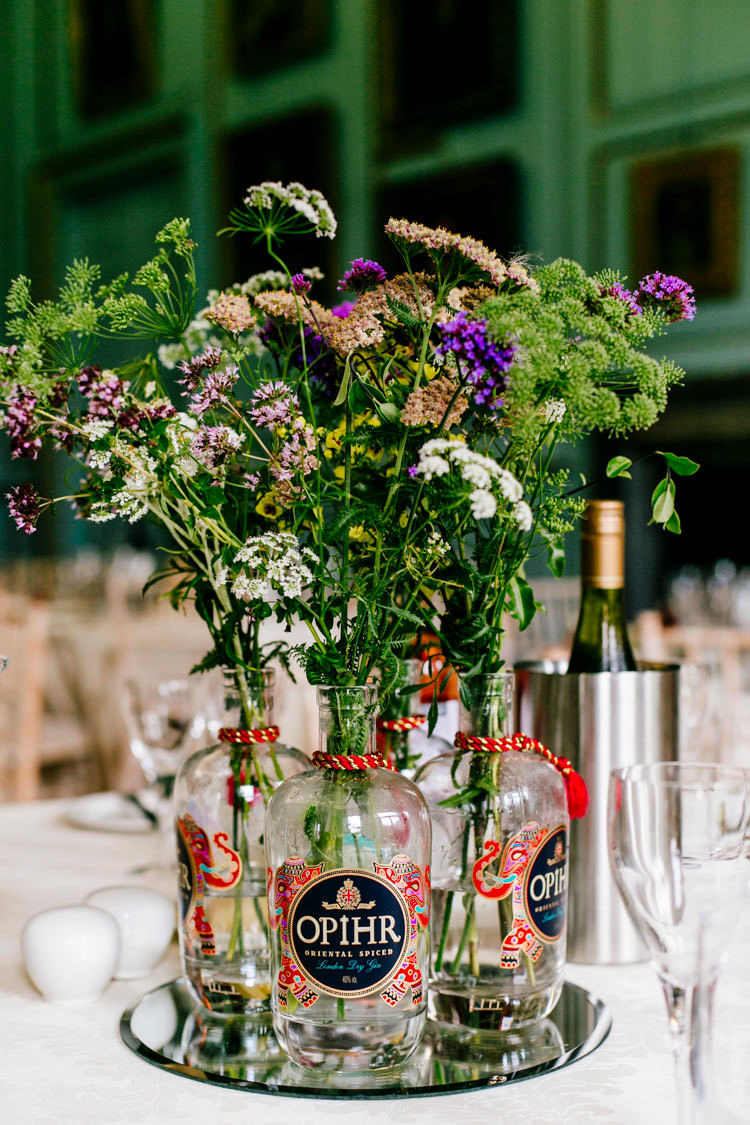 Opihr Centre Piece Bottle Flowers Floral Mirror Centre Table Stylish Sassy Gin Wedding http://epiclovestory.co.uk/