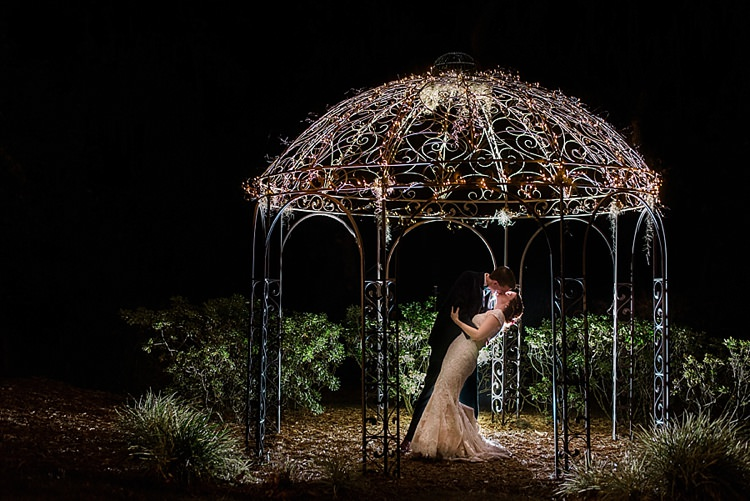 Pavilion Lights Kiss Bride Groom Romantic Twinkling Garden Wedding http://sarahben.com/