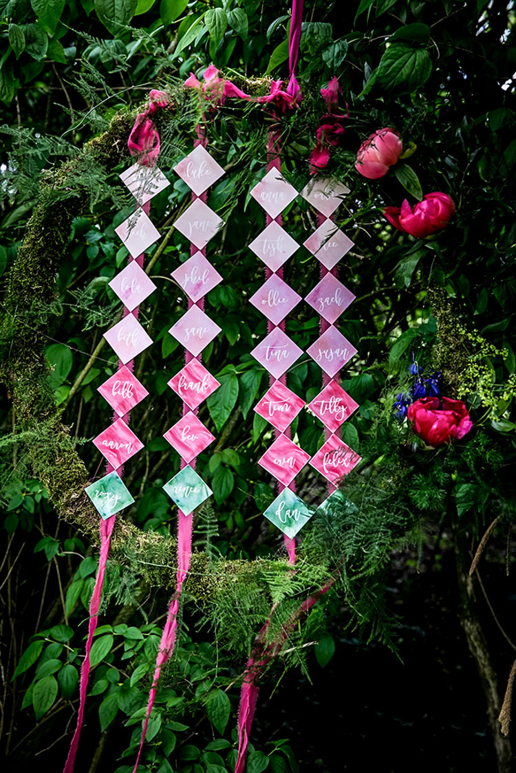 Seating Plan Table Chart Wreath Hanging Ferns Her Heart Was A Secret Garden Wedding Ideas Woodland Colourful Spring Bluebells Flowers http://sarabeaumontphotography.com/