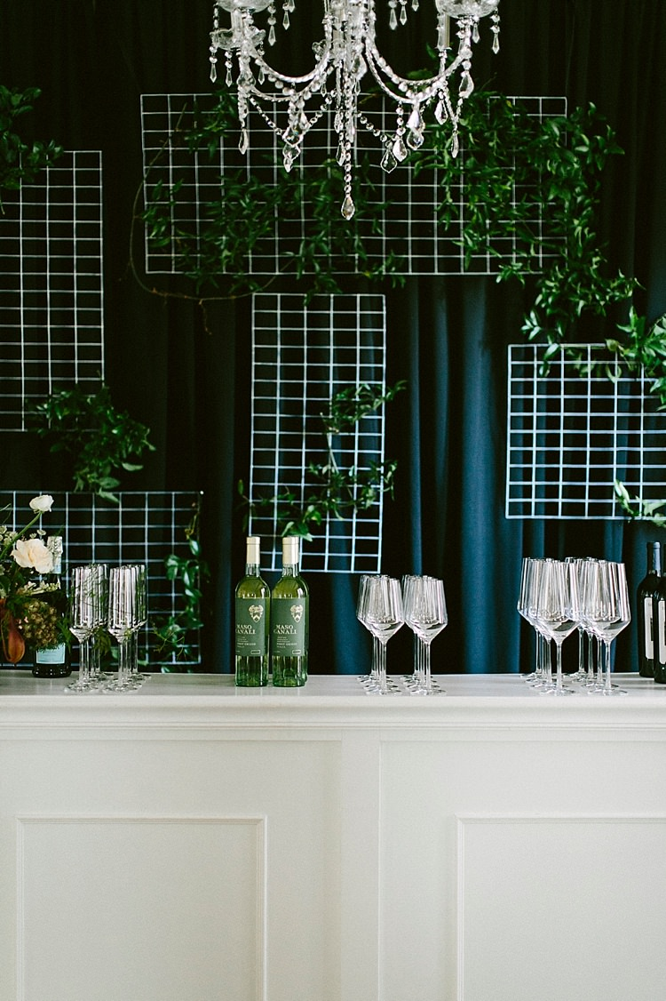Chandelier Glassware Bottles Wine Drinks Bar Modern Elegance Marble Greenery Gold Wedding Ideas http://www.jettwalkerphotography.com/