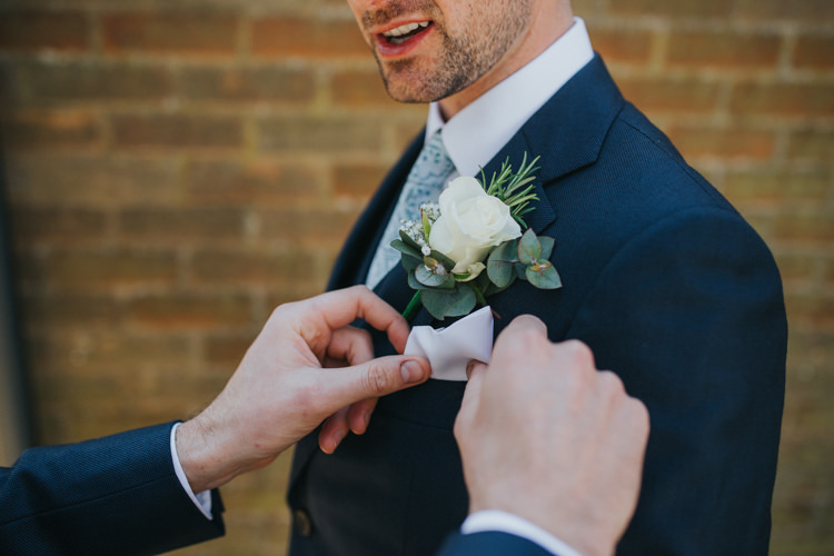 Buttonhole White Rose Groom Groomsmen Rosemary Eucalyptus Beautifully Serene Beachside Barn Wedding https://joshuapatrickphotography.com/