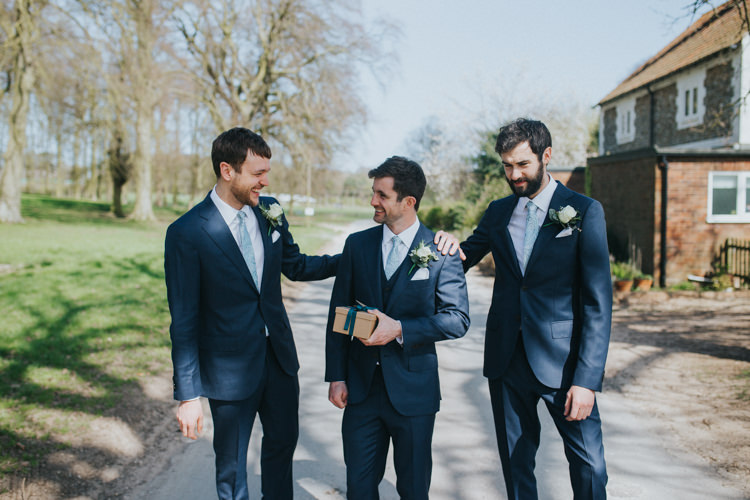 Groom Groomsmen Suit Supply Navy Blue Beautifully Serene Beachside Barn Wedding https://joshuapatrickphotography.com/
