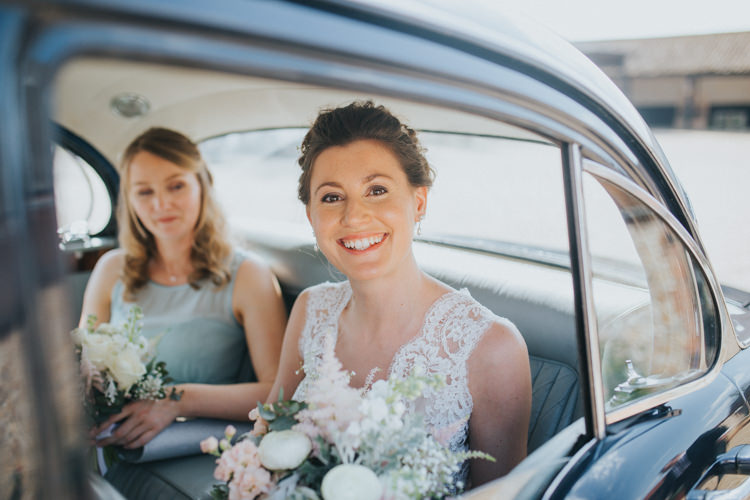Suzanne Neville Bride Bridal Lace Sleeveless V Neck Vintage Car Beautifully Serene Beachside Barn Wedding https://joshuapatrickphotography.com/