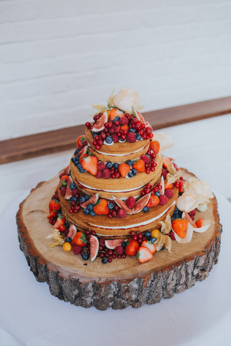 Naked Cake Fruit Berries Log Slice Stand Wood Beautifully Serene Beachside Barn Wedding https://joshuapatrickphotography.com/