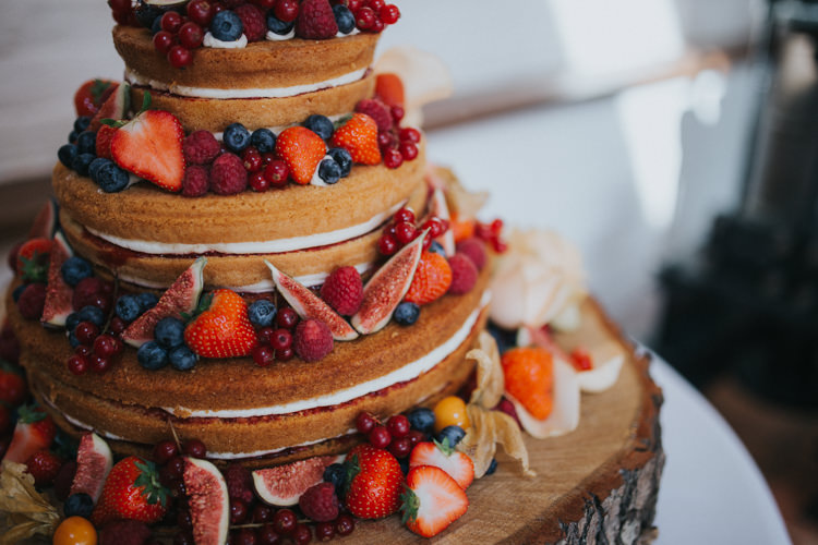 Naked Cake Berry Fruit Fig Log Stand Wood Slice Beautifully Serene Beachside Barn Wedding https://joshuapatrickphotography.com/