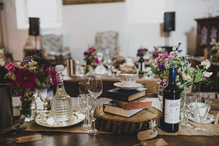 Tables Flowers Books Logs Hessian Quaint Floral Antique Rustic Wedding http://www.larissajoice.co.uk/