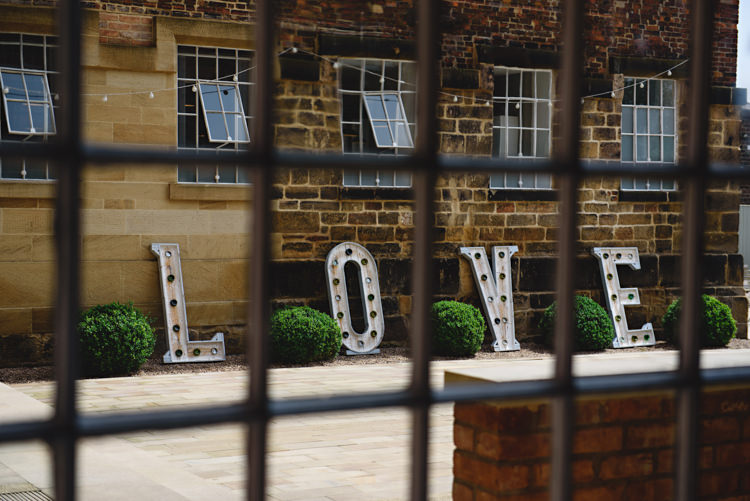 LOVE Letter Lights Industrial Rose Gold Dove Grey Greenery Wedding http://hbaphotography.com/