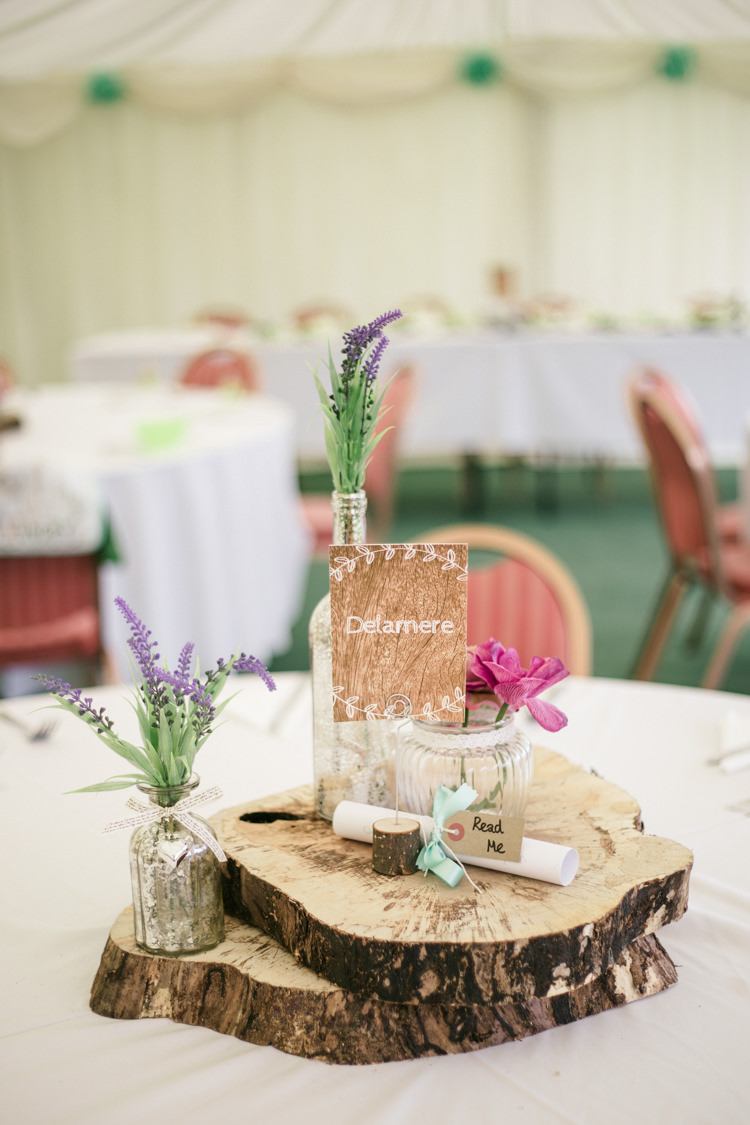 Decor Centerpiece Log Rustic Bottle Flowers Woodland Farm Camp Wedding http://emmastonerweddings.com/