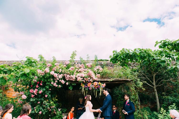 Flower Arch Backdrop Ceremony Colourful Mexican Garden Wedding http://jennifersmithphotography.co.uk/