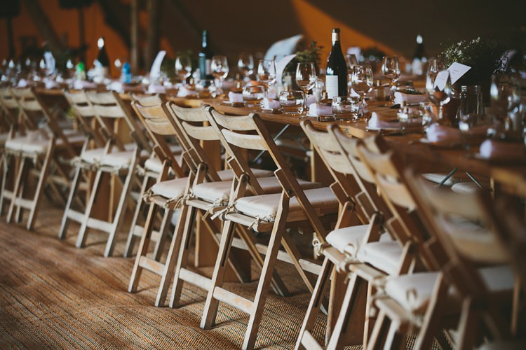 Rustic Wooden Chairs Folding Tables DIY Pretty Pastel Tipi Wales Wedding http://www.mckinley-rodgers.co.uk/