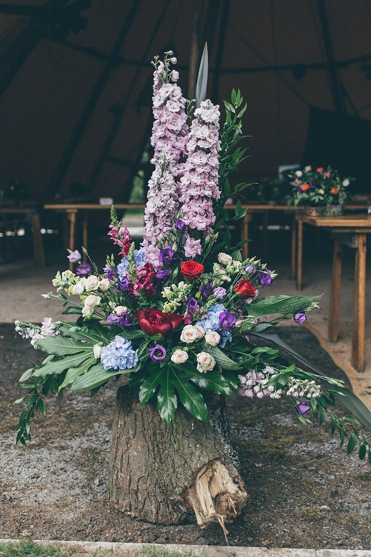 Flower Arrangement Tall Log Purple Red Blue Pink Beautiful Floral Bohemian Garden Wedding http://rachellambertphotography.co.uk/